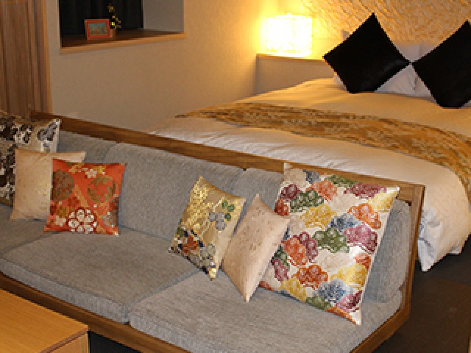 The low bed and couch were perfect for lounging, with plenty of soft cushions and fine linens.