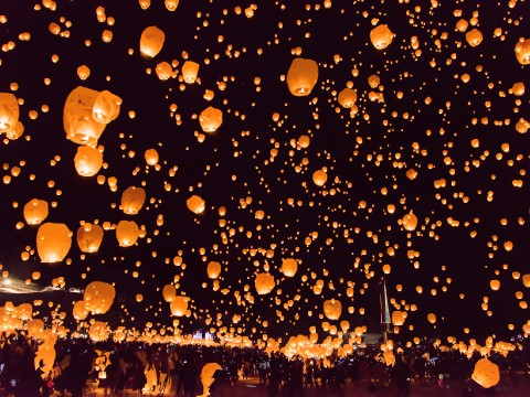 Thousands of lanterns being launched into the winter night sky is a fantastic spectacle images
