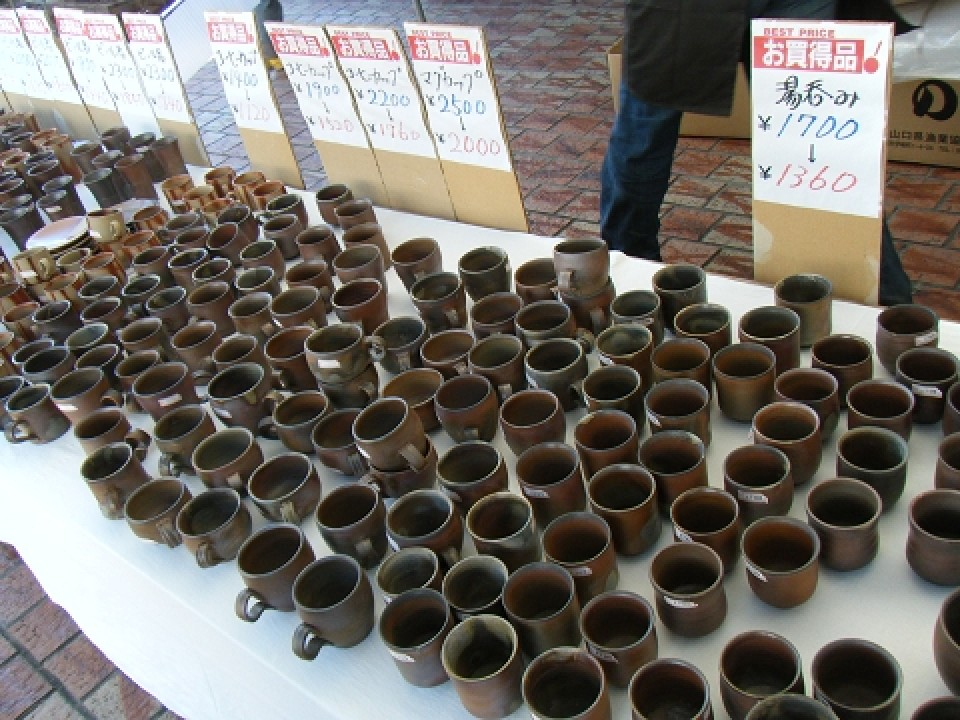 A selection of handmade cups are discounted and await customers.