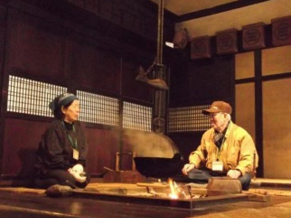 A fireside gathering scene.