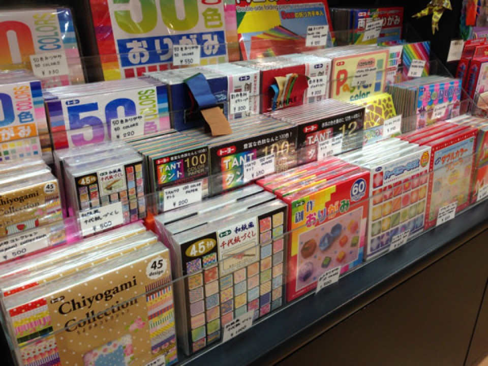 big selection of origami papers and books