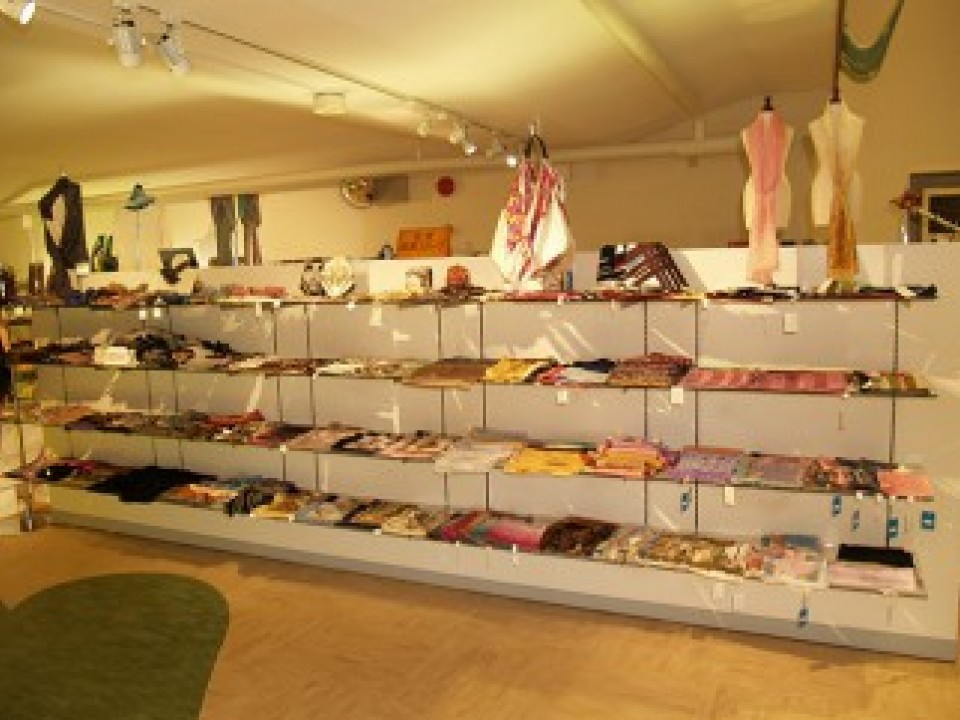 The museum shop sells silk scarves and other items having original designs.