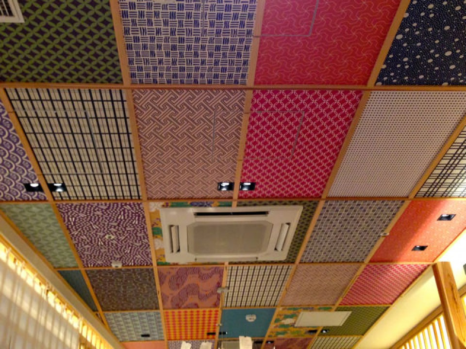 colourful traditional design on the ceiling inside the ramen shop