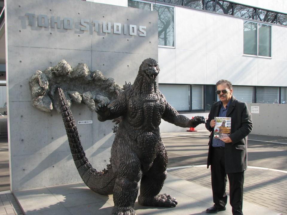 Armand Vaquer at the Godzilla statue at Toho Studios.