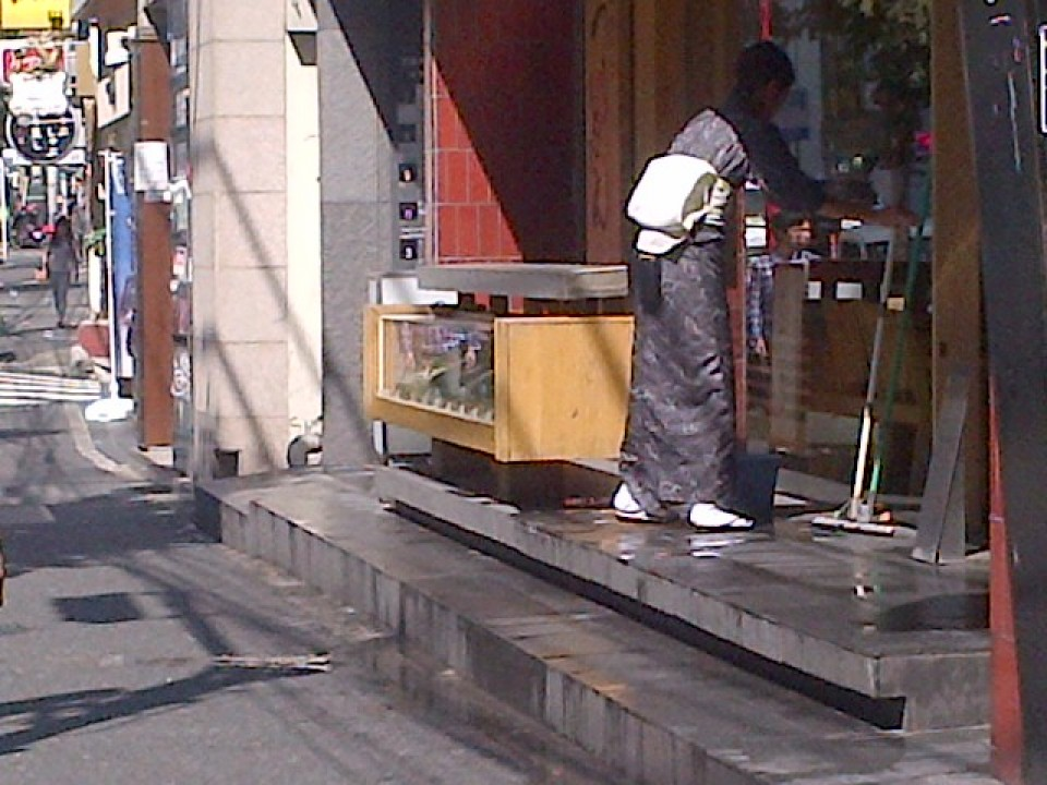 Early morning Kimono Beauty Keeping her Storefront Tidy