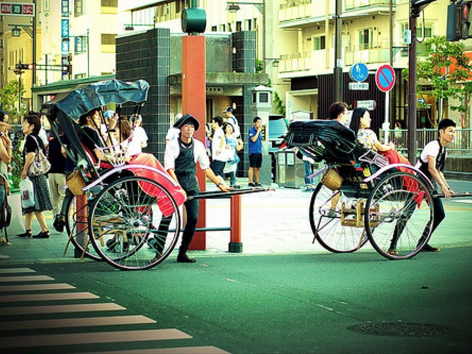 Two jinrikisha on the street