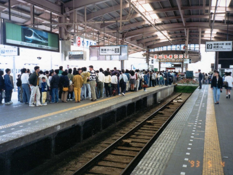 People Lining Up on the Platform