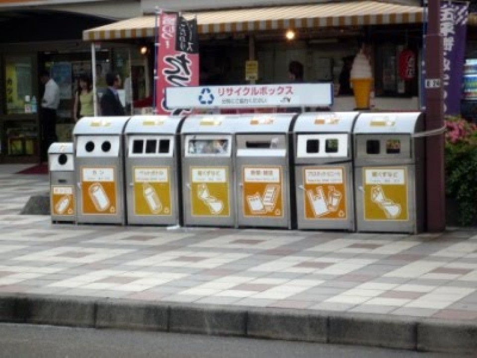 The trash bins in Japan are normally labelled with pictures.